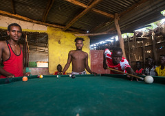 Young men playing snooker pool, Omo valley, Kangate, Ethiopia (Eric Lafforgue) Tags: africa people playing game color men pool horizontal outdoors picture indoors blackpeople omovalley ethiopia snooker hornofafrica eastafrica thiopien etiopia abyssinia youngmen menonly ethiopie realpeople etiopa smallgroupofpeople leisureactivity  etiopija ethiopi  ethnicgroup etiopien etipia  etiyopya       kangate    blackethnicity kangatan ethio161732