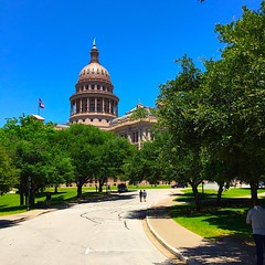 Capitol Green and Blue (Cesar's iPhoneography) Tags: trees green austin texas afternoon lawn americanflag bluesky treetops shade dome starsandstripes texasflag clearsky usflag atx texascapitol texasstatecapitol lonestarstate goddessofliberty texascapital stategovernment texashistory sunsetredgranite iphoneography txlege ioatx