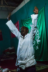 Sufi man goes into a trance during a ceremony, Harari region, Harar, Ethiopia (Eric Lafforgue) Tags: world africa travel people man color green vertical night religious outdoors togetherness dance clothing worship singing dancing african flag muslim islam religion praying group performance performing ceremony dancer unescoworldheritagesite celebration indoors event spirituality ethiopia sufi sufism adultsonly trance oneperson imam hornofafrica chanting eastafrica harar abyssinia harari onemanonly 1people harariregion ethio163035