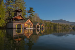 Lakeside Boat Houses (S A F I R E) Tags: lighting trees mist lake reflection art nature water sunrise landscape nikon scenery mood glow atmosphere scapes lakeplacid safire safirephoto