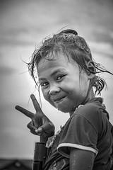 Salfika (nerdigwalking) Tags: poverty portrait white black beach wet monochrome smile kids strand swim children fun snorkel child dive victory kind malaysia borneo friendly personen lcheln schnorcheln armut lebenslust