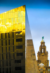 BRYAN_20160125_IMG_1100 (stephenbryan825) Tags: reflection glass yellow liverpool buildings graphic dusk dome threegraces albertdock royalliverbuilding dramaticlight portofliverpoolbuilding selects mannisland