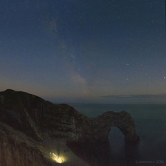 The Stars Look Beautiful Tonight - HSS! (lunaryuna) Tags: panorama landscape coast coastallandscape seascape durdledoor arch rockarch cliff bluff sky nightsky starrynight milkyway le longexposure peoplecamping nightlights nightphotography nocturnalphotography sliderssunday hss lunaryuna