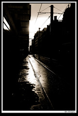 nov8 (The_Jon_M) Tags: street uk november light sunset england urban sun sunlight reflection reflections mosleystreet manchester puddle mono track glare tram greater damp mosley novemeber 2014 greatermanchester monovember