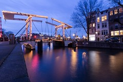 The illuminated bridge (McQuaide Photography) Tags: longexposure nightphotography bridge holland reflection water netherlands amsterdam night canon eos lights licht canal twilight europe nacht tripod nederland wideangle le bluehour brug dslr gracht lightroom uwa wideanglelens ultrawideangle 100d waltersuskindbrug 1018mm mcquaidephotography
