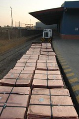 A train loaded with copper leaves the Impala terminal in Lubumbashi, DRC (Trafigura Images) Tags: africa june train truck republic lift transport rail railway fork warehouse copper congo impala democratic drc forklift cathode 2014 trafigura cathodes lubumbashi congothedemocraticrepublicofthedrcongo impalaterminals
