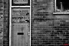 The print shop (CJS*64) Tags: door bw building shop wall blackwhite nikon bricks bolton frontdoor brickwork printers cjs nikkorlens hardmans theprintshop 18mm105mmlens nikond3100 craigsunter cjs64