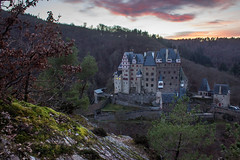 castle eltz in germany (Tobias Arhelger) Tags: old trees roof winter sky cold brick tower castle nature beautiful forest river germany rocks flag branches famous oldbuildings eifel roofs german valley knight walls middleages attraction mosel eltz