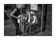 grocery shopping in Essex (jrockar) Tags: street city light shadow people urban blackandwhite bw woman london lady contrast shopping lens photography prime mono fuji shot candid streetphotography documentary rangefinder snap human madness elder blonde instant moment standard ordinary decisive ordinarymadness x100s