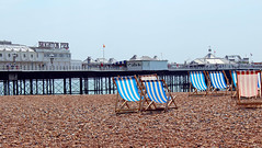 Palace Pier and deckchairs (melita_dennett) Tags: uk england beach sussex pier seaside brighton chairs palace east deck