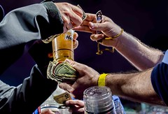 Beer Money (Wes Iversen) Tags: people chicago money beer illinois hands arms wrigleyfield liquid chicagocubs wrigleyville refreshments exchanges hcs churchkeys nikkor18300mm clichesaturday
