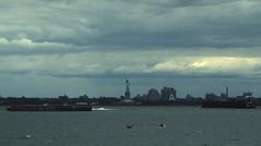 Statue of Liberty 294 (stevensiegel260) Tags: clouds statueofliberty barges newyorkharbor kayacks
