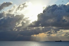 Outbound Freighter (ChristopherSmith.Photo) Tags: ocean light sky water clouds boat ship bright sunrays