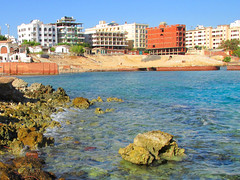 Hurghada Buildings and the Red Sea (shaire productions) Tags: egyptandthenile contikiegypt egypt adventure image picture travel world travelphoto photo photograph photography tour tourism country building exterior hurghada water sea ocean hotel resort rocks coast nature