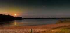 Before sunset. (augustynbatko) Tags: sunset sky sun lake beach nature clouds landscape sand