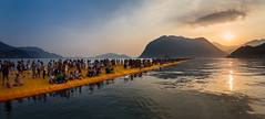 The People Walking On The Water (emacol09) Tags: sunset italy lake water bergamo brescia christo peple lombardy lakeiseo floatingpiers