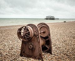 Rusty Winch (SKAC32) Tags: brown beach sussex pier rust brighton wheels shingle july pebbles cogs southcoast winch derelict dull breezy