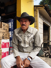 The old cowboy (BenoitDemers) Tags: adult cowboy elderly face farmer grandfather hat male man mature old outdoor outdoors person portrait rural senior smile cambodge