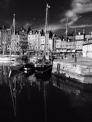 Old harbour in Normandy (grumpybaldprof) Tags: old sky bw france detail reflection building history tourism water st architecture clouds port buildings reflections boats lights la town ancient bars war harbour ships sails restaurants basin historic catherine years 100 normandie honfleur slate picturesque etienne normandy ste quai vieux collombage quarantaine lieutenance