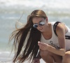"wind on the beach (explore) (Gay Foster) Tags: beach girl sunglasses canon wonder concentration wind shell ""long ""canon hair"" ""holding elenafosterpray"