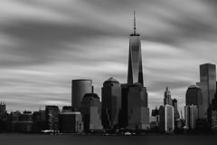 New York - Freedom Tower (gregsino) Tags: nyc longexposure sky blackandwhite newyork building buildings river noiretblanc manhattan financialdistrict ciel hudsonriver immeuble immeubles freedomtower poselongue