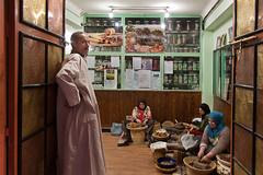 Lavoro in eboristeria - (Herbalist's shop: women is preparing Argan oil) (patrizia.lungonelli) Tags: morocco marocco donne olio lavoro terapia argan erboristeria cosmesi