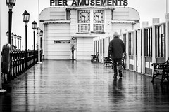 Lone Stroll (ToonManic) Tags: england wet lines architecture canon ian photography sussex pier worthing westsussex unitedkingdom 85mm coastal 7d mm raining 85 leading pearson repitition ianpearson toonmanic