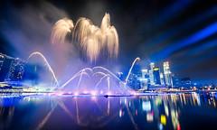 Spotlight (hugociss) Tags: new city urban skyline marina landscape golden bay singapore cityscape waterfront fireworks anniversary jubilee year newyear spotlight laser cbd sands 50th countdown raffles 2014 2015 sg50