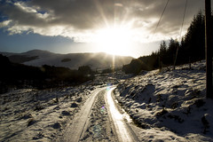 Balquhidder. (Jawn McClenaghan.) Tags: trees winter sun mountain ice nature forest trek climb scotland highlands glare view bright walk hill tracks scottish hike flare editorial stirlingshire thetrossachs scottishhighlands lochlomand balquhidder jawnmcclenaghan tristanharper