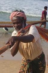 Fishermen's labour (yuriye) Tags: fishermen man work labour india indian varkala net fishing old portrait sea muslim fisherman inspiredbylove kerala look ethnic malayalam ngc