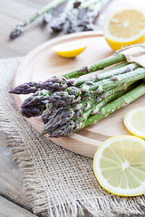 Bunch of fresh green asparagus spears (victoria.kondysenko) Tags: new food green closeup menu season cuisine wooden spring raw spears rustic seasonal vegetable whole asparagus crop meal tips vegetarian bunch string diet bundle agricultural nutritious ingredient