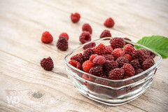 Juicy raspberries (WDnet) Tags: wood red summer food plant macro green nature glass beauty closeup fruit vintage garden studio table wooden leaf juicy healthy berry natural sweet background tasty plate fresh delicious health snack d750 raspberry organic raspberries freshness ripe vitamin forestfruits