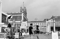 hanging out on the boardwalk (mfauscette) Tags: 35mm fsc ishootfilm istillshootfilm kodak kodakportra400 nikon nikonf6 analog asburypark blackandwhite boardwalk film filmisnotdead filmshooterscollective jerseyshore street