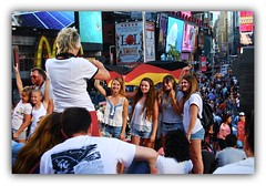 Double Celebration (Eddie Hales) Tags: nyc ny smile view manhattan flag tourists timessquare visitors germans ribbet crowed