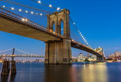 Brooklyn Bridge (Amar Raavi) Tags: brooklynbridge bridge eastriver river water waterfront riverfront brooklyn urban skyline outdoor newyorkcity nyc newyork ny unitedstates usa iconic old cablebridge suspensionbridge neogothic manhattan lowermanhattan downtownmanhattan bluehour dusk