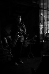 Rimlit Cool (Ranford Stealth) Tags: fujixt1 fuji35mmf14 fremantle westernaustralia cafe jazz music musician sax saxophone saxophonist baritonesax guitar guitarist windowlight mood moody blackwhite blackandwhite monochrome mono light shadow