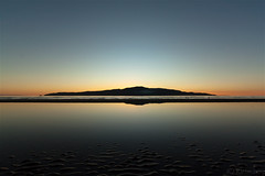 Kapiti Island dusk. (bob_katt) Tags: kapiti island paraparaumu beach sky sea silhouette sand northisland newzealand dusk low tide rangituhi channel canon eos500d coast smoke shore weather wave w