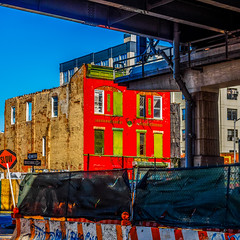 UndertheBridge.jpg (Klaus Ressmann) Tags: nyc bridge autumn red color facade contrast cityscape colorfull olympus system squareformat williamsburg klaus oldbuilding omd em1 ressmann omdem1 flccity klausressmann olympusomdsystem