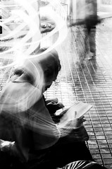 Multiple Halos (BryonLippincott) Tags: street light blackandwhite bw lightpainting motion rain bench tile book interesting squares circles exploring fineart taiwan streetphotography explore motionblur slowshutter mostinteresting oldwoman taipei mrt streaks existence absorbed walkingby shilinmrtstation shilinstation streettog bryonlippincott