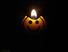 Smile? (Aaroncillo) Tags: light shadow art smile dark happy fire photography candle darkness artistic fear creepy conceptual gil flickrfriday flickeringlights aarón aaroncillo