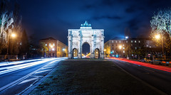 Siegestor (Philipp Klinger Photography) Tags: road street city longexposure trip travel blue trees light vacation sky holiday tree cars car stone architecture night clouds munich mnchen bayern deutschland bavaria nikon gate europa europe long exposure cityscape arch angle taxi tripod oberbayern wide trails illumination wideangle victory cobblestones cobble trail hour triumphalarch bluehour tor quadriga philipp siegestor d800 triumphbogen triumphal schwabing klinger maxvorstadt steingaden victorygate ludwigstrase