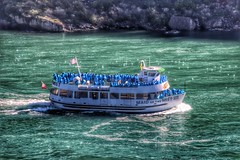 Niagara Falls  Ontario  ~ Canada ~ Maid of The Mist ~ Classic Shot (Onasill ~ Bill Badzo) Tags: world park city travel blue autumn sky sun mist newyork macro reflection fall nature leaves night clouds canon river lens rebel lights drive see boat site rainbow flickr view state dr famous scenic sigma tourist casino tourists historic waterfalls flare rays horseshoe dslr must tours maidofthemist casinos app attraction sl1 rainbowbridge horseshoefalls madi riverroad eriecounty canadain riverrd nrhp seein niagaracounty 18250mm onasill snapseed