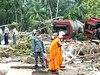 A Buddhist monk stands with a military officer in front of a train that was washed away by the waves in the southern village of Peraliya, killing over 1,000 people. Credit: Amantha Perera/IPS