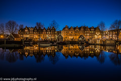 Mirror of luck (JdJ Photography (www.jdj-photography.nl)) Tags: city trees sky holland reflection netherlands amsterdam boats evening living canal dock bomen europa europe apartments quiet bright nederland boten bluehour innercity avond lucht mokum helder continent current tranquil province houseboats stad noordholland gracht mirroring weerspiegeling reflectie benelux wonen randstad westerdok dok binnenstad rustig provincie northholland stroming woonboten appartementen amsterdamcentrum zandhoek rustiek blauweuur