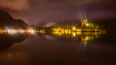 Colour Ble(e)d (Motographer) Tags: slovenia slowshutter longexposure reflection blejskojezero lake bled triglav nationalpark uppercarniola radovljica europe julianalps church waterfront mountains hills forest travel centraleurope colors colourful nikon d750 50mm nikkorafs50mmf18g lights night nightscape rain island
