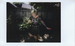 Day 047 (H o l l y.) Tags: lomography lomoinstant fuji instax mini instant photo self portrait analog film dancing twirl dress fashion girl summer grass fence urban hot outside beautiful weather lace shadow flash retro indie vintage