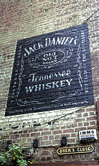 Jack Daniels advert, Edinburgh (andronicusmax) Tags: character advert advertisment whiskey old time brick wall edinburgh dyersclose cowgate jackdaniels weathered paint painted sign city building alley corner close wynd