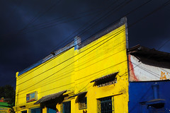 Mur jaune | Yellow wall | Pared amarilla (Eric Dupuis) Tags: canada southamerica yellow wall clouds jaune pared photography photo san eric colombia artist foto photographer photographie village juan cloudy quebec montreal pueblo stormy august bolvar agosto amarillo cielo tormenta fotografia mur contrasts 2012 artista fotografo aot artiste contrastes photographe dupuis colombie amriquedusud nuageux sudamrica americadelsur ericdupuis nepomuceno orageux contrastos sanjuannepomuceno nublando ricdupuis