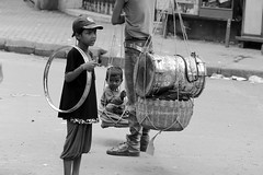 Gypsies (pathikdebmallik) Tags: street people blackandwhite india child circus tricks kolkata gypsies calcutta