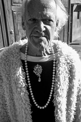 yeah.. bejeweled (jon.depped) Tags: street bw animal fur dc washington character streetphotography pearls creepy fujifilm jewels joyous bejeweled x100